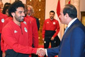 Mohamed Salah (left) shaking hands with Egyptian President Abdel Fattah al-Sisi on Saturday before the team left for Russia.