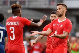 Switzerland's Haris Seferovic (right) celebrating with teammates after scoring.