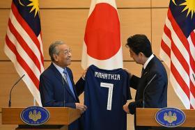 Mahathir: High-speed rail 'postponed' not scrapped