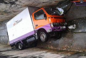 SBS lorry falls into drain, two men taken to hospital