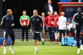 (From left) Kylian Mbappe, Antoine Griezmann and Ousmane Dembele are likely to form France's attack in their opener against Australia.