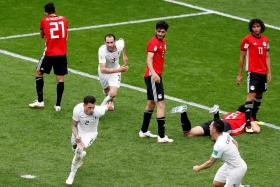 Jose Gimenez (bottom) racing away in celebration after heading in Uruguay's 89th-minute winner.