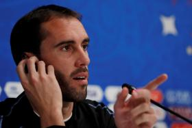 Uruguay's Diego Godin bristles at a question on whether they will follow Sergio Ramos' example of stopping Mohamed Salah.