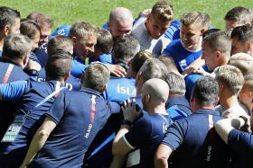 Iceland's team (led by coach Heimir Hallgrimsson in the centre) having a huddle during training.