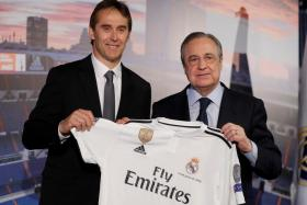 Julen Lopetegui (left with Real president Florentino Perez) being presented as Real Madrid coach, after he was sacked as Spain's manager.