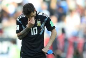 Lionel Messi cuts a dejected figure.