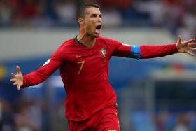 Cristiano Ronaldo celebrates after scoring their 88th-minute equaliser.