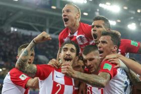 Croatia players celebrating after Luka Modric (partially hidden) scored from the spot.