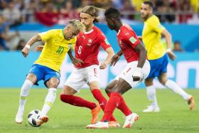 Brazil's Neymar getting attention from Switzerland's Michael Lang (centre) and Breel Embolo.