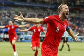England captain Harry Kane leads the celebrations after scoring the 91st-minute winner.