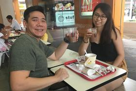 Mr Leon Dai and his wife at KFC Hougang Mall yesterday.