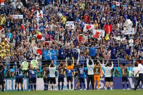 The Japan team acknowledging their supporters after Tuesday's historic win over Colombia.