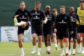 England captain Harry Kane leading the way in training.