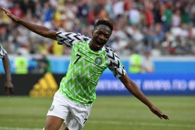 Nigeria's Ahmed Musa celebrates after scoring their second goal.