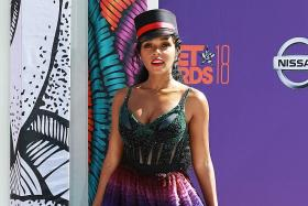 Janelle Monae brings rainbows to the red carpet