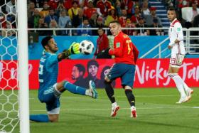 Iago Aspas equalising for Spain in injury-time.