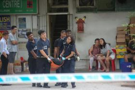 Body of a man being moved. He was killed after falling into a dough making machine at Ng Kian Seng Confectionery at 17 Bedok South Road.