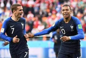 Kylian Mbappe (right) celebrating with Antoine Griezmann after scoring in the 1-0 win over Peru.