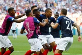 The France team celebrate after Kylian Mbappe scored their fourth goal.