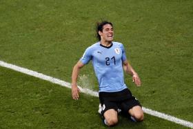 Edinson Cavani celebrating after his first goal.