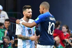 France's Kylian Mbappe consoling Argentina's Lionel Messi after the match.