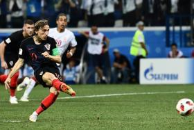 Luka Modric's penalty in extra-time was saved (above). But that did not stop him from volunteering to take another one during the shoot-out which Croatia won.