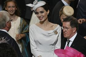 Hollywood royalty Angelina Jolie does British royalty - and reigns