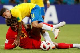 Belgium's Marouane Fellaini tackling Brazil's Philippe Coutinho.