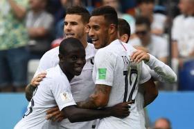 France players celebrating Antoine Griezmann's goal.