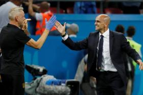 Roberto Martinez (right) celebrates with a member of his staff after defeating Brazil.