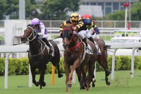 Glorious Forever (in gold and-black) breaking the Sha Tin 2,000m course record and giving jockey Zac Purton the second leg of his four-bagger at Sha Tin on Sunday.
