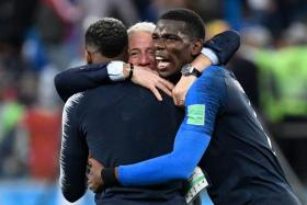 France coach Didier Deschamps celebrating with Paul Pogba (right) and Presnel Kimpembe.
