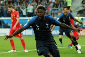 France's Samuel Umtiti celebrating after scoring from a corner.