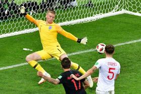 Croatia's Mario Mandzukic (in black) scoring their extra-time winner past England's Jordan Pickford.
