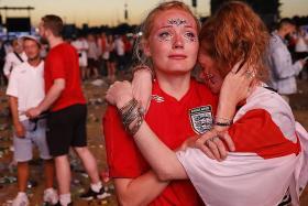 Forlorn but proud, fans applaud England despite defeat