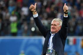 France coach Didier Deschamps celebrating his team's semi-final victory over Belgium.