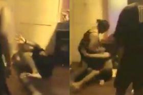The couple are seen repeatedly hitting the two men in the video.