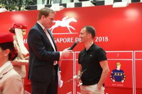 Champion jockey Vlad Duric being interviewed by Singapore Turf Club presenter Nicholas Child after drawing barrier 9 for Emirates Singapore Derby favourite Elite Invincible yesterday.
