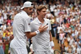 John Isner (left) congratulating Kevin Anderson after the latter won their six-hour, 36-minute Wimbledon semi-final.