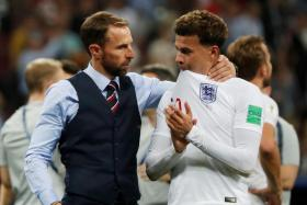 England manager Gareth Southgate consoling Dele Alli after their semi-final defeat by Croatia.