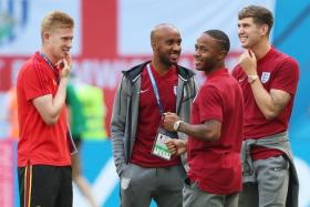 Belgium's Kevin de Bruyne (left) speaking to his Manchester City teammates and England players Fabian Delph (second from left), Raheem Sterling (second from right) and John Stones before the World Cup third-place play-off on June 14.