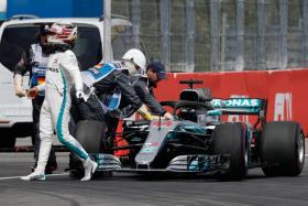 Lewis Hamilton walking away from his car after a technical problem during qualifying.