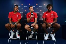 (From left) Pierre-Emerick Aubameyang, Aaron Ramsey and Alex Iwobi speaking at a media event on Friday (July 27).