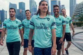 (From left) Arsenal's players Henrikh Mkhitaryan, Mesut Oezil, Hector Bellerin, Pierre-Emerick Aubameyang and Petr Cech unveiling the club's third kit at the Esplanade in Singapore on Friday (July 27).