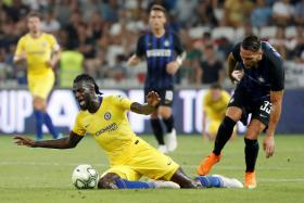 Inter Milan's Danilo D'Ambrosio (right) in action with Chelsea's Tiemoue Bakayoko.