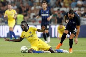 Inter Milan's Danilo D'Ambrosio (right) in action with Chelsea's Tiemoue Bakayoko.