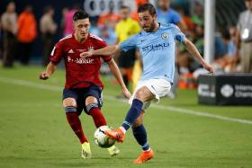 Manchester City's Portuguese midfielder Bernardo Silva (seen here with Bayern's Jonathan Meier) scored two goals to help secure a 3-2 win.