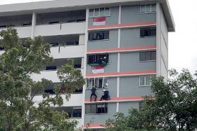 SCDF stop man from jumping, police wrest knife and arrest him