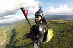 Paragliding athlete Jessica Goh taking a selfie while on a leisure flying trip in Ranau, Sabah, where she has been training hard for the Asian Games.