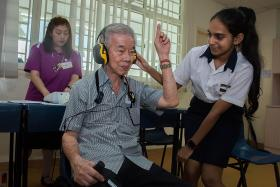 Young and old bond at health screening